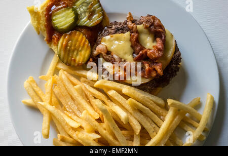 Bacon cheeseburger with French fries - Stock Photo