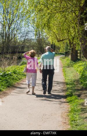 Elderly Couple Walking Holding Hands