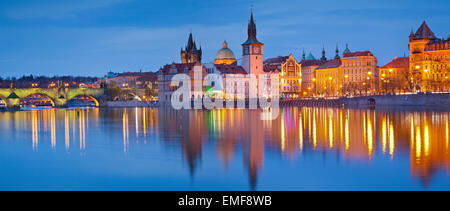 Prague Panorama. Panoramic image of Prague riverside and Charles Bridge, with reflection of the city in Vltava River. - Stock Photo