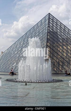 The Pyramid Le Louvre Paris France - Stock Photo
