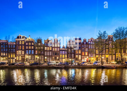 Historic Houses Amsterdam Singel 396 - 366 at night. Amsterdam Canal houses romantic scenic view at sunset. - Stock Photo