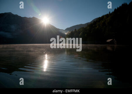 sunrise over Altausseer See with morning mist, Altaussee, Styria, Austria - Stock Photo