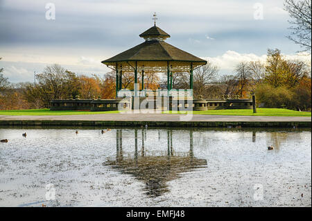Bandstand and pond in Huddersfield, England. - Stock Photo