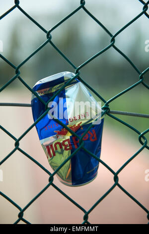 a can jammed in the fence - Stock Photo