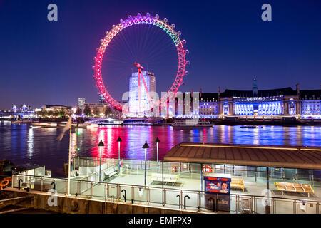 The London Eye and River Thames At Night London UK - Stock Photo