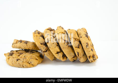 Chocolate chip cookies stacked next to each other isolated - Stock Photo