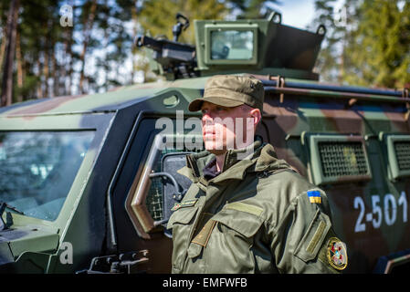 Lviv, Ukraine. 20th Apr, 2015. Ukrainian officer stands near the one of three humvees offered by american army to - Stock Photo