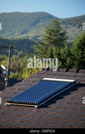 Solar vacuum tubes for heating domestic water on a roof in the south of France - Stock Photo