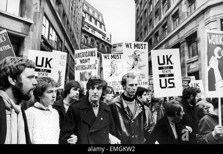 Marchers protest in Aldwych, London during a mass Anti Vietnam war rally. 27th October 1968. - Stock Photo