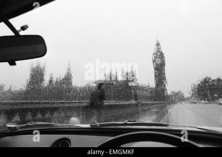 General view of the Houses of Parliament and Big Ben taken through the rain washed window of a car. 28th November - Stock Photo