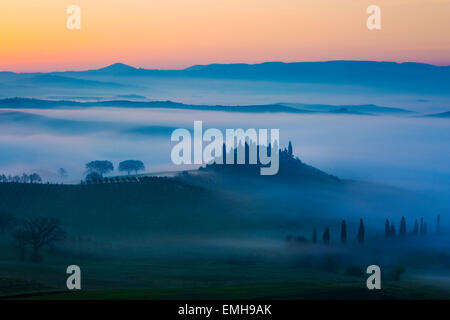 Podere Belvedere and the Tuscan countryside at dawn, San Quirico d'Orcia, Tuscany, Italy - Stock Photo
