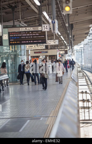 TOKYO, JAPAN - CIRCA APR, 2013: Japaneses walk on the Tokyo station platform. Empty railway. The Tokyo Station is - Stock Photo