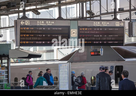 Information board is at the railway station in Tokyo in Japanese language. Marunouchi district of Chiyoda, Japan - Stock Photo