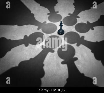Winning together business team symbol teaming up to defeat a powerful opponent with eight chess pawns encircling - Stock Photo