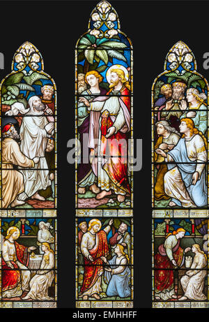 The Raising of Lazarus of Bethany depicted in stained glass in St. Mary's Church, Ambleside, Cumbria, England, UK - Stock Photo