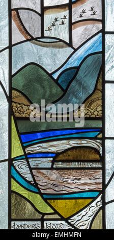A 20th century stained glass window featuring Herbert's Island, Keswick St. John Church, Cumbria, England, UK - Stock Photo