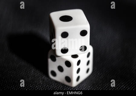 High angle view and close up of two rubber dice - Stock Photo