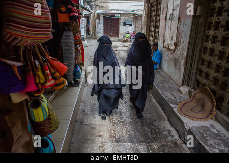 women in traditional dresses in Zanzibar - Stock Photo