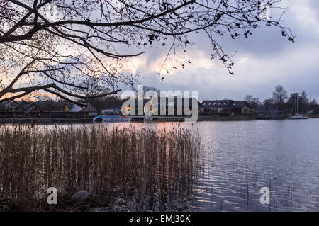 Trakai village by Galve lake in Autumn at sunset, Trakai, Lithuania - Stock Photo