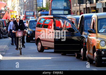 London, UK. 21st Apr, 2015. United Cabbies Group blocks Oxford Street with Taxis in protest at the failure of TFL - Stock Photo