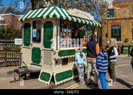A Family Buying Ice Creams From a Traditional Ice Cream Van, Richmond Upon Thames, London, England - Stock Photo