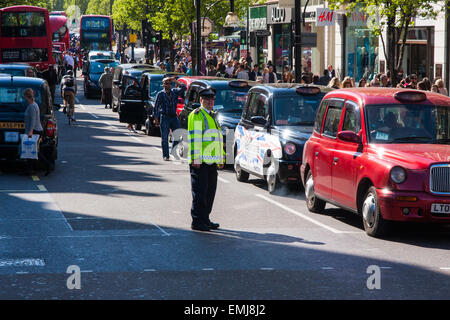 London, UK. 21st April, 2015. Hundreds of London black taxi operators bring traffic to a standstill as they protest - Stock Photo