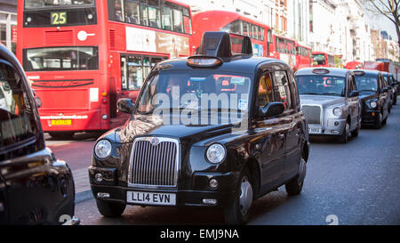 Oxford Street, London, UK. 21 April 2015.  London black cab taxi drivers, members of the United Cabbies Group, take - Stock Photo