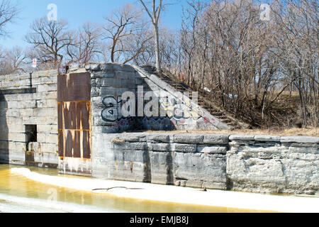 Grafitti on the first lock of the historic Soulange Canal. - Stock Photo