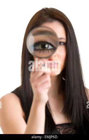 Woman looking through a loupe isolated in white - Stock Photo