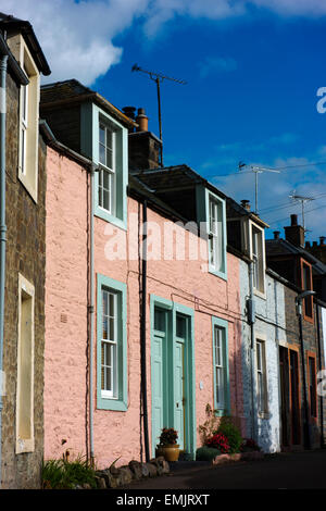 Traditional worker's cottages painted pastel colours in Moffat, a former spa town and centre for the wool trade. - Stock Photo