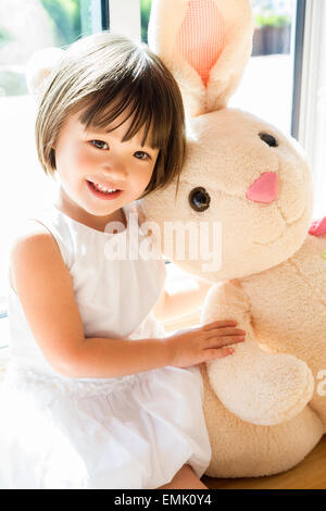 Sweet toddler girl with her Easter bunny - Stock Photo