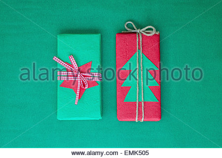 Overhead view of small red and green Christmas gifts - Stock Photo
