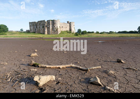 Pembrokeshire, Wales : medieval castle ruins facing a drained pond - Stock Photo