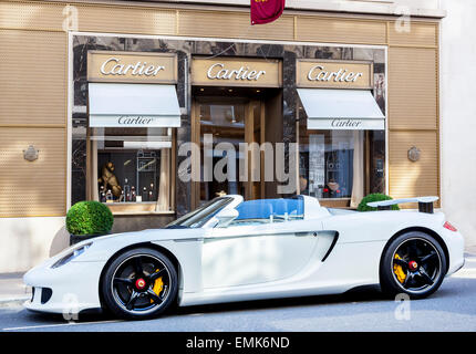 Porsche Carrera GT parked in front of the Cartier jewelry store, London, England, United Kingdom - Stock Photo