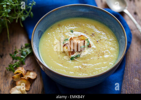 Parsnip soup with parsnip crisps - Stock Photo