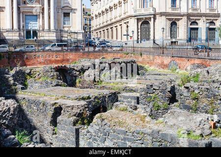 ancient roman amphitheater (Anfiteatro Romano) and Church San Biagio in Piazza Stesicoro in Catania, Sicily - Stock Photo