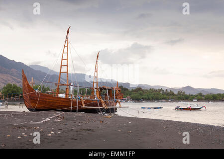Replica merchant ship, traditional wooden boat on beach, Pemuteran, Bali, Indonesia - Stock Photo
