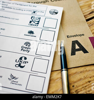 UK Political Parties - Filling in a postal vote form for the UK general election 2015 - Stock Photo