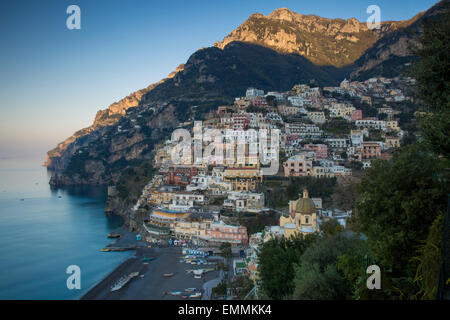 Early morning sunlight first touching the mountains above Positano along the Amalfi Coast, Campania, Italy - Stock Photo