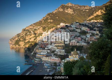 Early morning sunlight on the mountains above Positano along the Amalfi Coast, Campania, Italy - Stock Photo