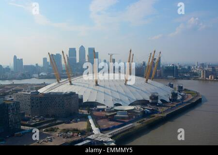 The O2 Arena on the Greenwich Peninsular, London, England. Aerial view with Docklands in background - Stock Photo