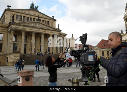 Berlin, Germany. 22nd Apr, 2015. The cameraman Anis adjusts the camera position for the shooting of the Arabic TV - Stock Photo