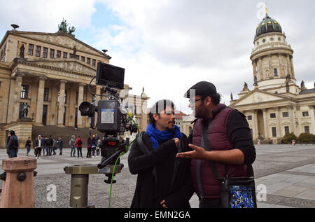 Berlin, Germany. 22nd Apr, 2015. The director Ali Al Ali (R) and actor Mohammad Almusalam during the shooting of - Stock Photo