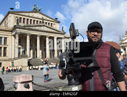 Berlin, Germany. 22nd Apr, 2015. The director Ali Al Ali stands next to the camera during the shooting of the Arabic - Stock Photo