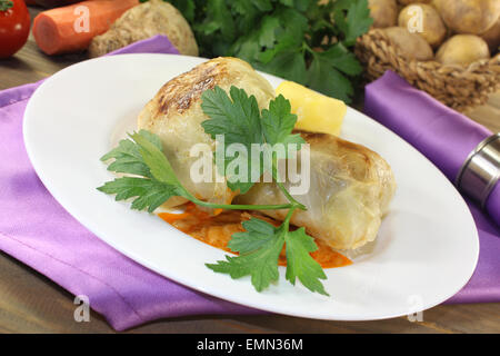 braised Stuffed cabbage with parsley on a checkered napkin - Stock Photo