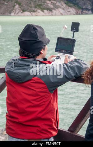 Man using a camera drone at Serrano Glacier in a Chilean national park - Stock Photo