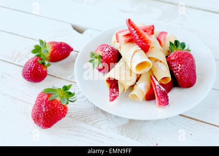 Pancakes with fresh strawberry fruits and castor sugar - Stock Photo