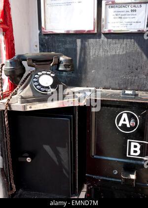 Vintage Telephone Box with old phone. England. UK. - Stock Photo