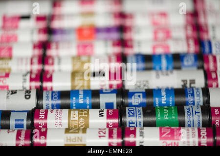 rolls of old 120 roll film unexposed a waste product of of analogue photography replaced by digital technologies - Stock Photo