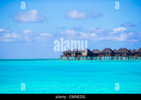 Water villas, bungalows on ideal perfect tropical island - Stock Photo